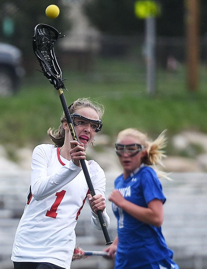 Makenna Keyek passes the ball Thursday as the Steamboat girls lacrosse team picked up a win against Fruita Monument.