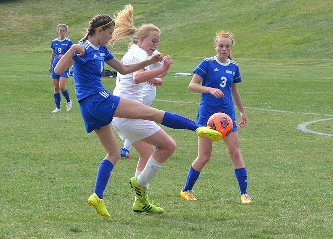 Moffat County High School's Makenna Baker braces herself as Roaring Fork's Kloe Lee takes a high kick. MCHS soccer fell 6-1 against the Rams Thursday.