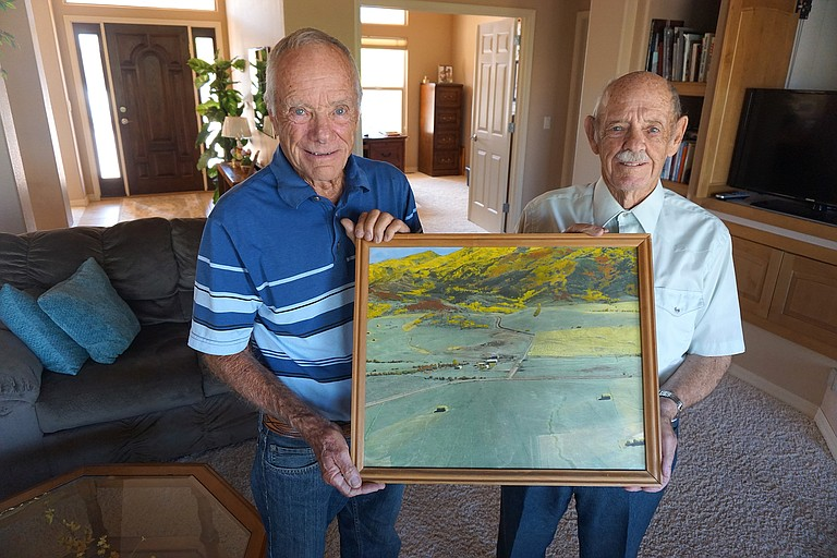 Glenn Arnold, left, and his brother, Gerald, hold a photograph of the Arnold family farm they grew up on near what is now the base of Steamboat Ski Area.