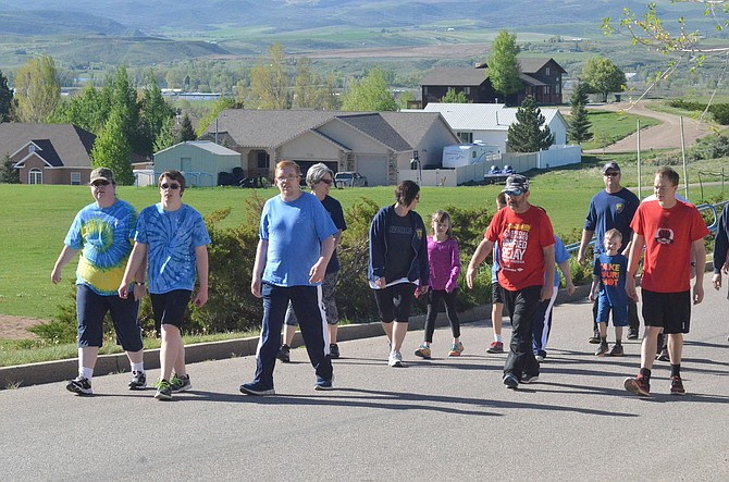 Athletes make their way up to the Moffat County High School track as part of Saturday's Western Region Special Olympics Spring Games. The annual event featured about 100 total competitors in track and field and aquatics from Craig, Steamboat Springs, Montrose and Delta.