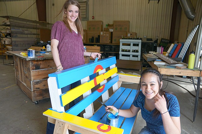 Storage sheds, tables, benches, chairs and racks made from horseshoes are among the many items made by MCHS students for this year's FFA Auction, which begins at 5:30 p.m. on Friday in the high school gym. Pictured are Payton Voloshin, left, and Makayla Martinez.