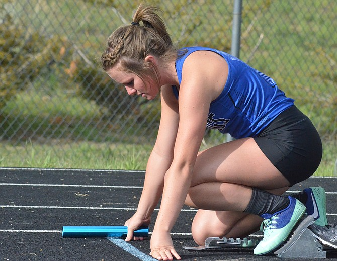 Moffat County High School's Emma Samuelson centers herself in preparation for the girls 4x400-meter relay at the Clint Wells Invitational. MCHS track and field will send 15 athletes in 12 events to the state championships this week in Lakewood. Qualifiers include Samuelson, Josie Timmer, Jenna Timmer, Stephenie Swindler, Mattie Jo Duzik, Abby Bohne, Liberty Hippely, Morgan Nelson, Keenan Hildebrandt, Riley Allen, Miki Klimper, Grant Wade, Carter Severson and Connor Scranton.