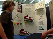 Willy Gun explains his project at the Invention Convention on Thursday at Lowell Whiteman Primary School.
