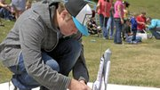 "Moffat County High School students launch rockets Friday during the science department's ""Rockin Rockets"" competition."